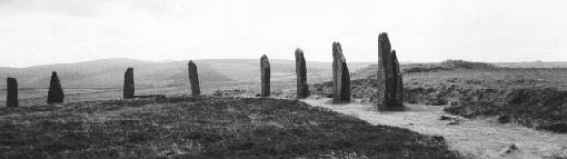 black and white photograph of a row of tall, standing rocks from the Ring of Brodgar on the Orkney Islands north of Scotland